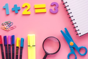 School supplies on pink background for education and back to school concept