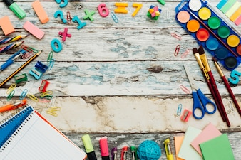 School supplies on rustic wooden table.
