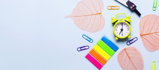 School supplies and orange leaves