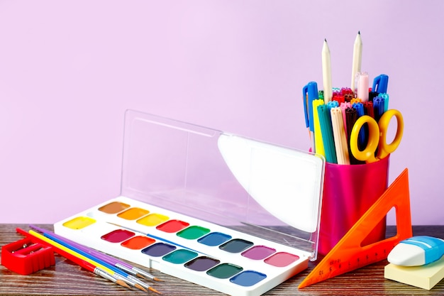 School supplies on a pastel background
