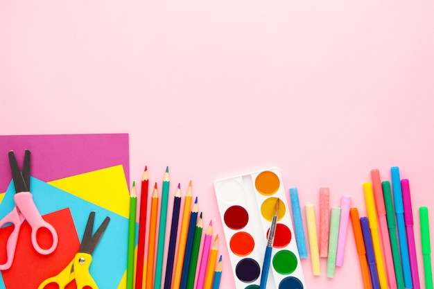 School supplies on pink background with copy space. back to school. flat lay.