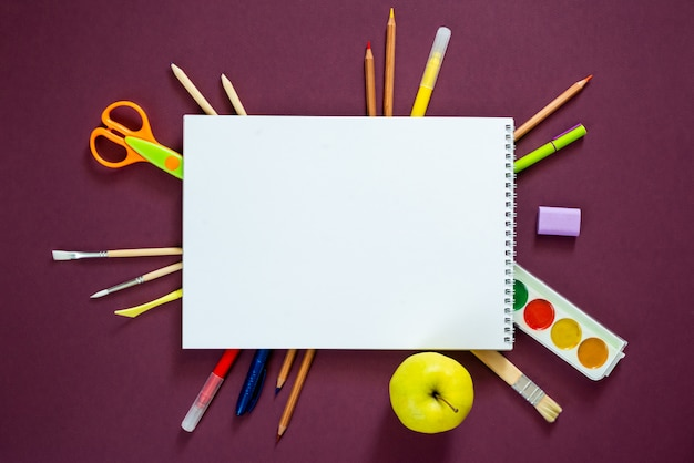 School supplies on a purple background