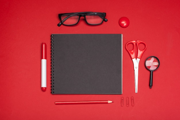 School supplies on red table top view