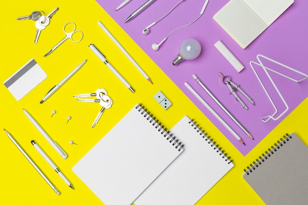 School supplies set at colorful paper