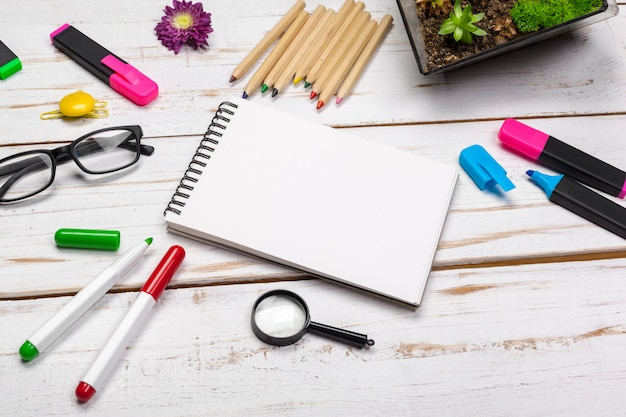 School supplies, stationery accessories on wood