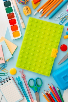 School supplies stationery on blue, back to school concept with copy space for text