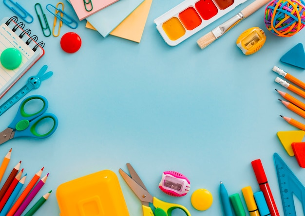 School supplies stationery on blue, top view