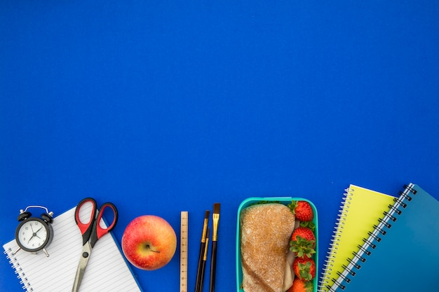 School supplies with alarm clock and lunchbox