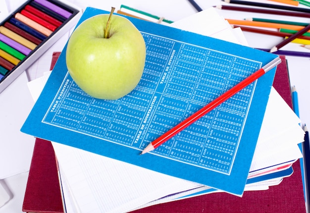 School supplies with an apple