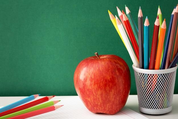 School supplies with blackboard background