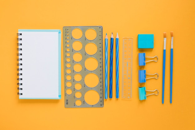 School supplies with blank notebook