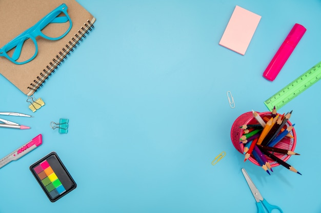 School supplies with middle space for text .
