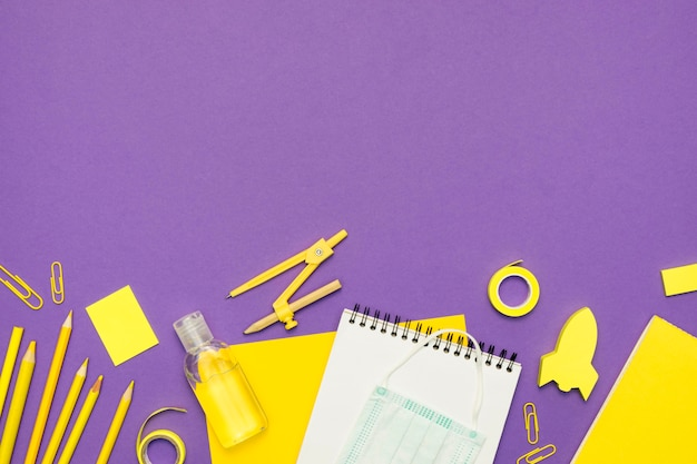 School supplies with purple background