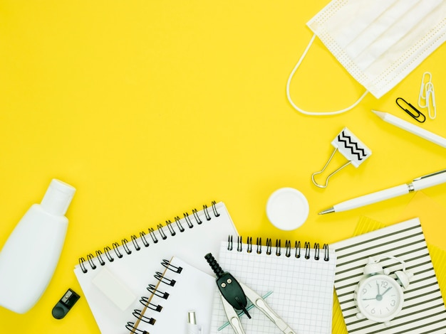 School supplies with yellow background