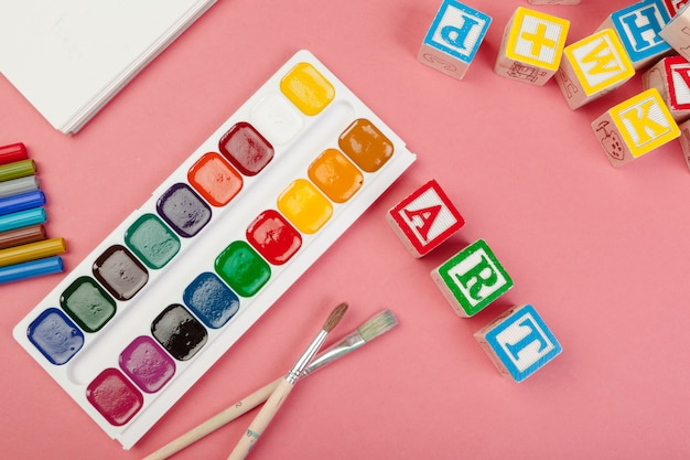 School supplies and wooden alphabetical cubes