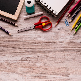 School supplies on wooden surface