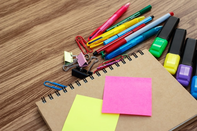 School supplies on a wooden table with space for text