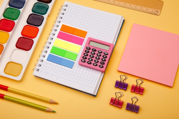 School supplies on yellow background. back to school abstract image