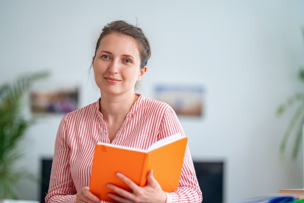 School teacher explains lesson topic online