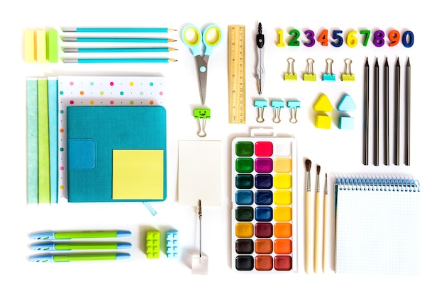 School tools on white background. top view.back to school, school supplies - pencils and paints, ruler and eraser, paper clips and scissors, notepads and notebooks.