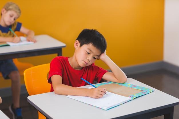 Schoolboy doing her homework