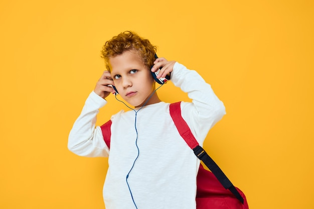 Schoolboy headphone entertainment active lifestyle of youth