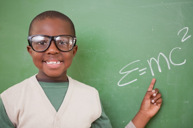 Schoolboy showing the the mass-energy equivalence formula