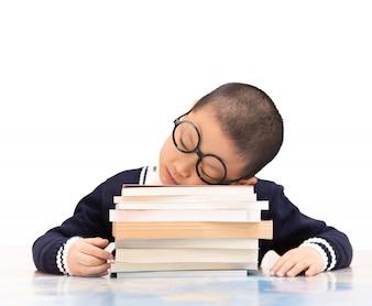 Schoolboy sleeping on school books