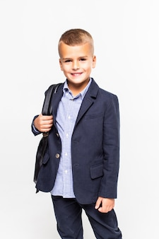 Schoolboy with bag isolated on a white wall