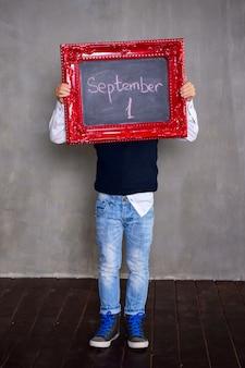 Schoolboy with blackboard. school concept