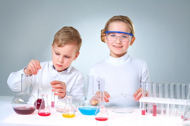 Schoolchildren playing with experimental substances
