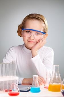 Schoolgirl in chemistry class