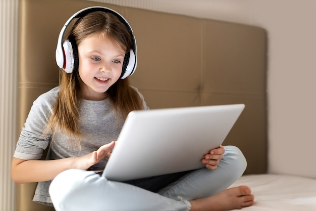 Schoolgirl children lifestyle online concept