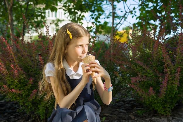 Schoolgirl eating ice cream.