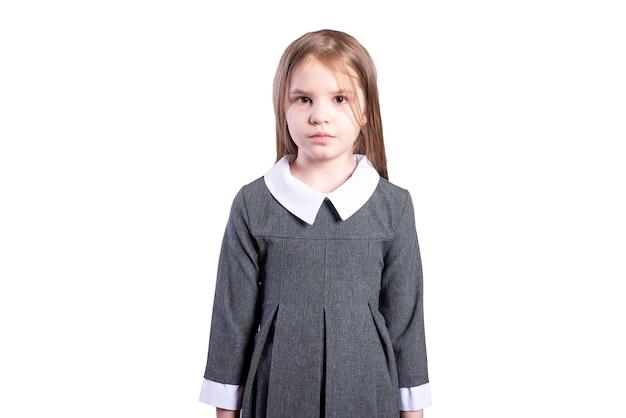 ビジネス制服を着た女子高生。白い背景で隔離。高品質の写真