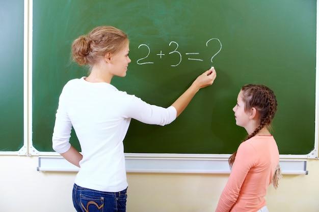 Schoolgirl in math class