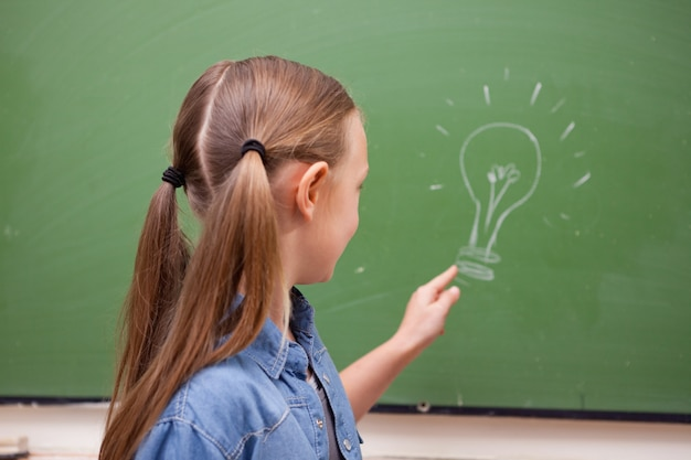 Schoolgirl pointing at a bulb