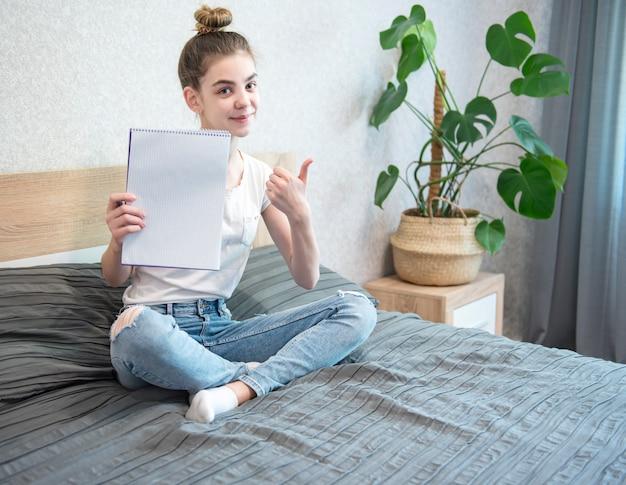 Schoolgirl studing at home