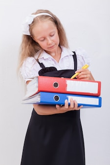 Schoolgirl with folders