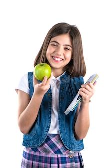 白地にノートブックとリンゴを持つ女子高生