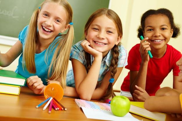 Schoolgirls laughing in class