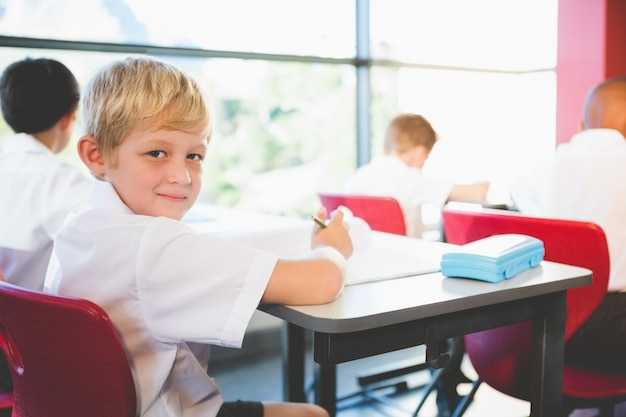 Schoolkids doing homework in classroom