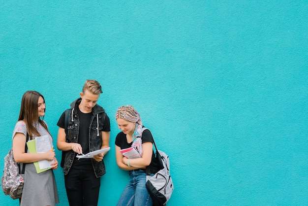 Schoolmates at turquoise wall
