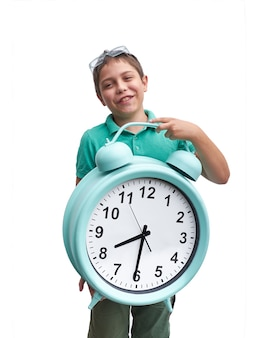 Schools start too early. little boy with large gren alarm clock.