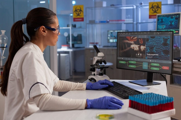 Science specialist using computer for dna research