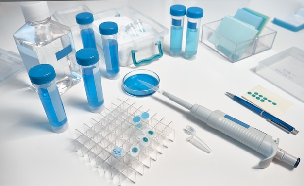 Scientific background, closeup on automatic pipette