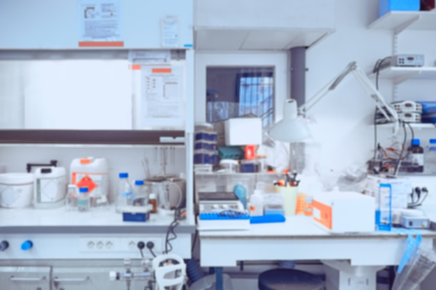 Scientific background: modern laboratory interior out of focus, toned image