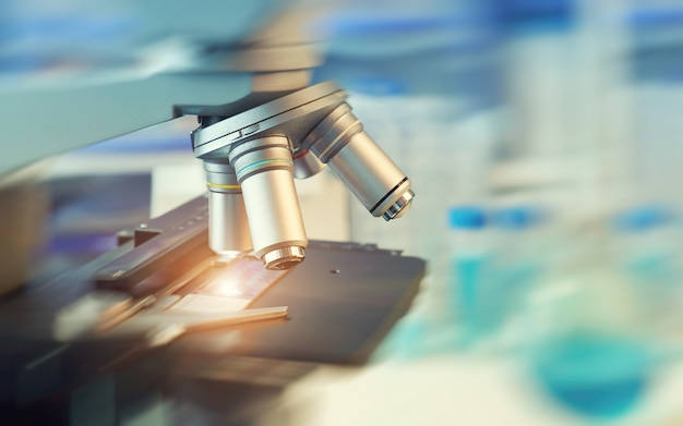 Scientific concept with closeup on light microscope and blurred laboratory