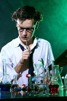 Scientific doing chemical experiment