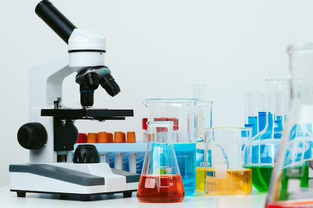 Scientific laboratory with microscope and test tubes with samples